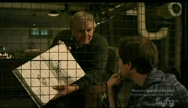 Douglas showing Josh his notebook