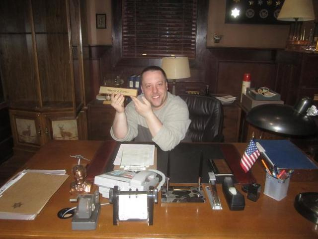 Chad Colvin at Sheriff Carter Office Desk Eureka during set visit