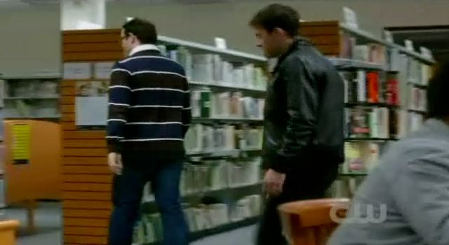 Supernatural S7x15 - Man in library walking toward Marjorie Willis