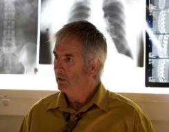John Jarratt as Paul the Coroner in Needle!