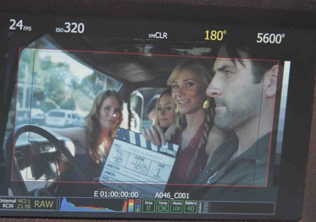 BTS Mika Boorem holds slate as cast Paige Howard Rick Faugno Elizabeth Masucci Patrick Zeller shoot scene
