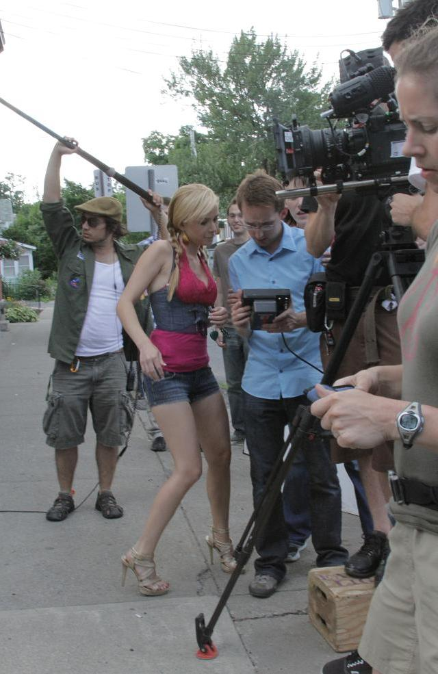 BTS Director Sean Fallon checks the monitor with actress Mika Boorem]