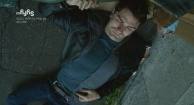 Being Human S3x10 - Aidan is knocked out behind some garbage cans in an alley