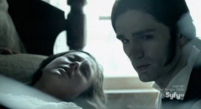 Being Human S3x10 - Aidan looks at the dead child wrapped in cloth as Susanna looks on