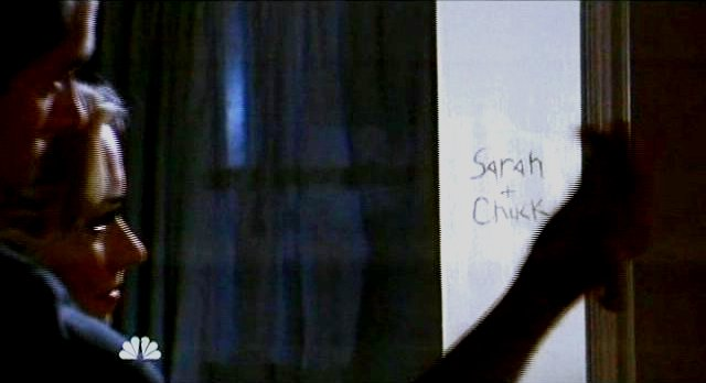 Chuck S5x08 - Sarah and Chuck carved in wood