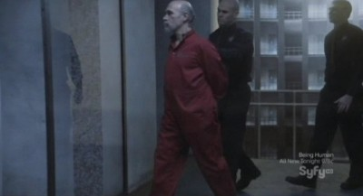 Continuum S1x10 - Kagame is lead to his cell at CPS HQ