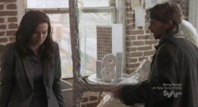 Continuum S1x10 - Kiera and Jason in time travel lab with Infinity monument and models of terrorist target