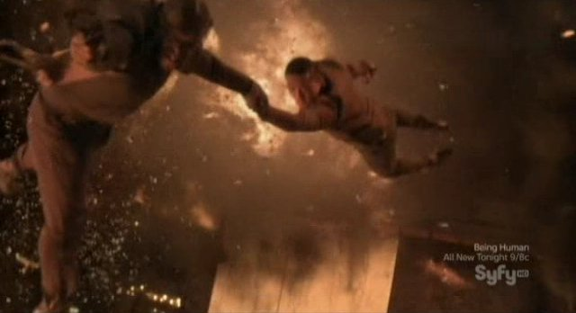Continuum S1x10 - Travis and Curtis escape as the building explodes