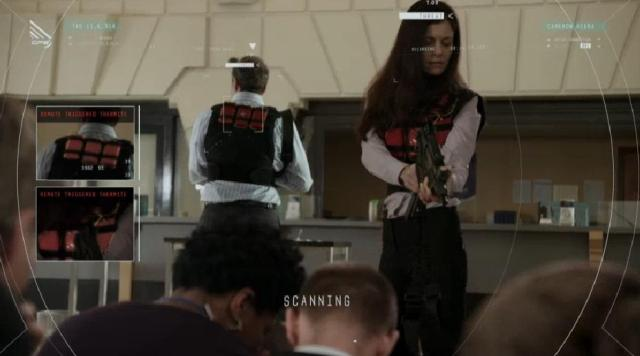 ContinuumS03X03 Kiera uses her tech to examine the robbers vests