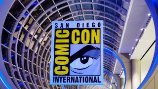 San Diego Comic Con Logo - Click to follow Comic-Con International on Twitter!