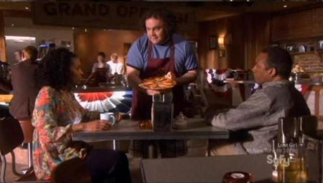 Eureka S5x04 - Vincent serves pizza to Grace Henry
