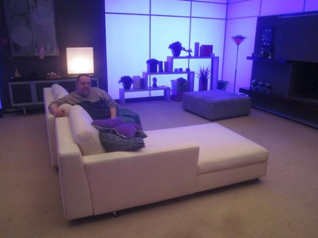 Chad Colvin lounging on Carters Couch during Eureka set visit