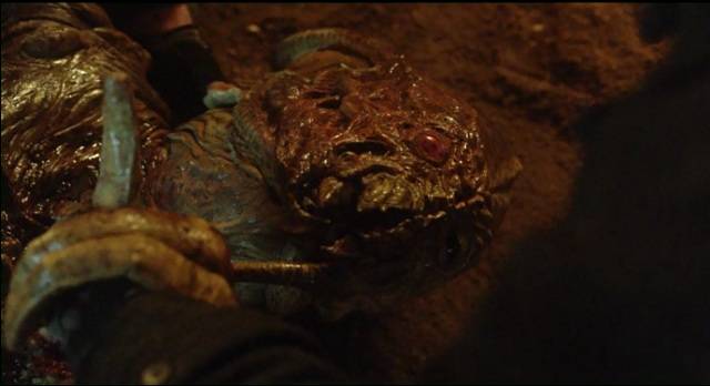 Falling Skies S2 x 10 Tom holding red eyes hand