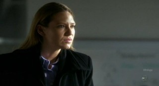 Fringe S4x12 - Olivia listens intently to Walter in the lab
