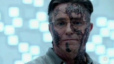 Fringe S5x03 - Hideously disfigured Bark Person Edwin Massey in the crystalline memory data bank facility
