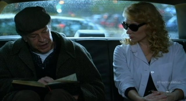 Fringe S5x09 - Examining the notebook in the taxi with Dr Warren