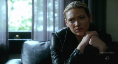 Fringe S5x11 - Olivia looks on with deeps emotions as September relates his circumstances