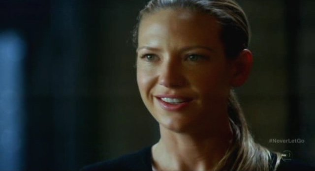 Fringe S5x11 - Olivia smiles at their discovery of Walter's memories