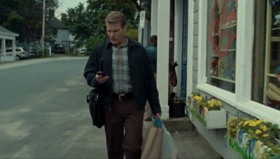 Haven S4x06 - The victim Seth is apparently reading a text message in front of the Haven Travel office