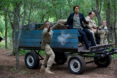 """Revolution S2x05 - Neville fires to protect Allendford killing the rogue Patiot commander """"One Riot, One Ranger"""" Episode 205 -- Pictured: (l-r) Giancarlo Esposito as Major Tom Neville, Nicole Ari Parker as Secretary Justine Allenford -- (Photo by: Felicia Graham/NBC)"""