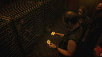 Revolution S2x02 - Guards take blood samples from Miles and Sheriff mason while caged outside the Red Door