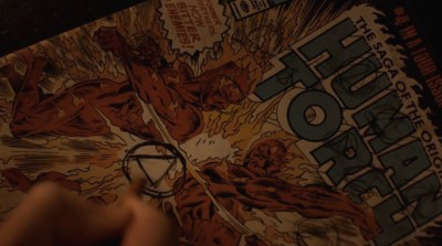 Revolution S2x06 - Aaron is drawing the Patriot symbol on the Human Torch comic book