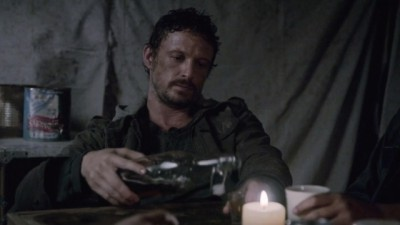 Revolution S2x06 - Monroe on a drinking binge after slaughtering all the inhabitants in the adjoining settlement three years after the blackout