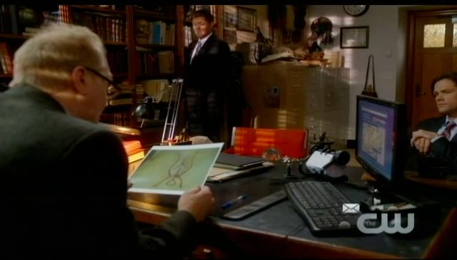 Supernatural S7x13 - Professor Morrison looking at the symbol being carved in to victim's chests