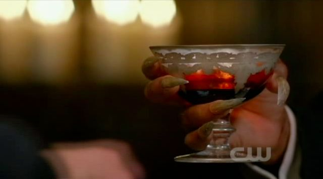 Supernatural S7x22 - The Alpha hands over a cup of his blood to Sam